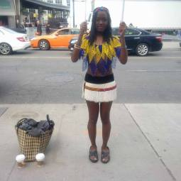 On May 8th, Amanie stood outside in the cold in tribal South Sudanese clothing to raise awareness for the women and children that were raped or tortured during war.